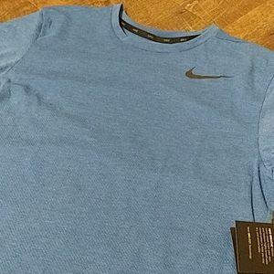 NWT. Blue Nike short sleeve shirt.